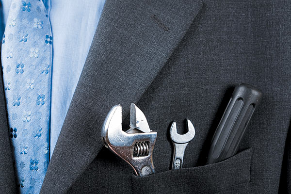 Tools in business suit pocket